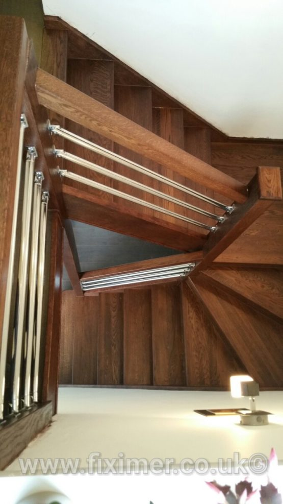 Staircase renovation with chrome pipe banister