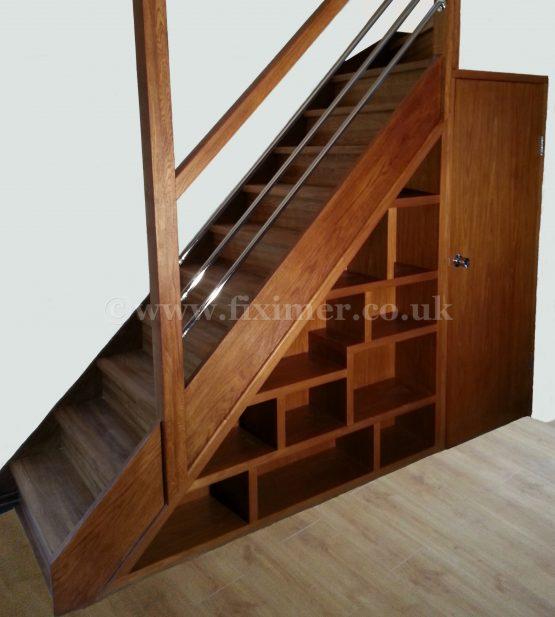 Oak under stair book shelving